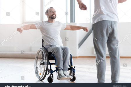 stock-photo-attentive-disabled-man-training-in-the-gym-with-the-orthopedist-574510306
